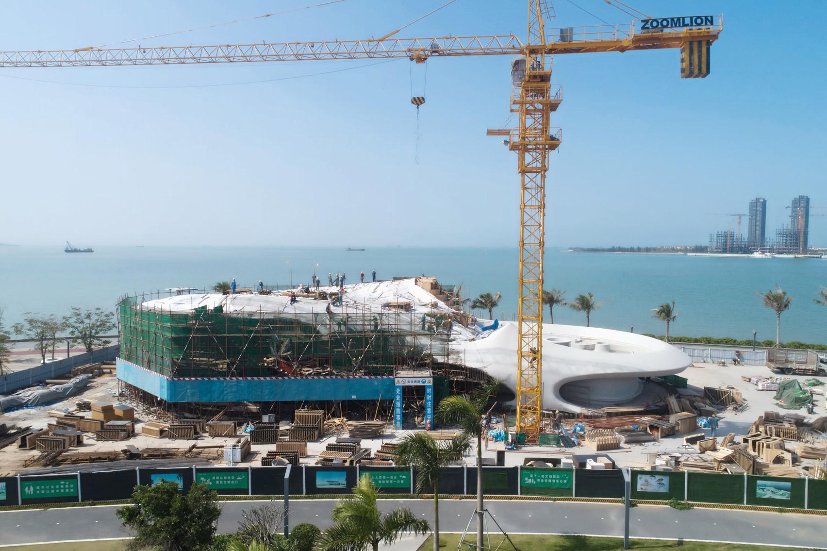 A construction photo of a coastal library