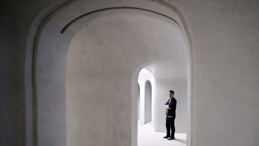 The white concrete interior of Wormhole Library