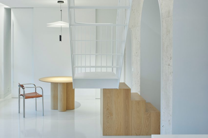 Arched doorways and wood and steel staircase in Vilnius apartment