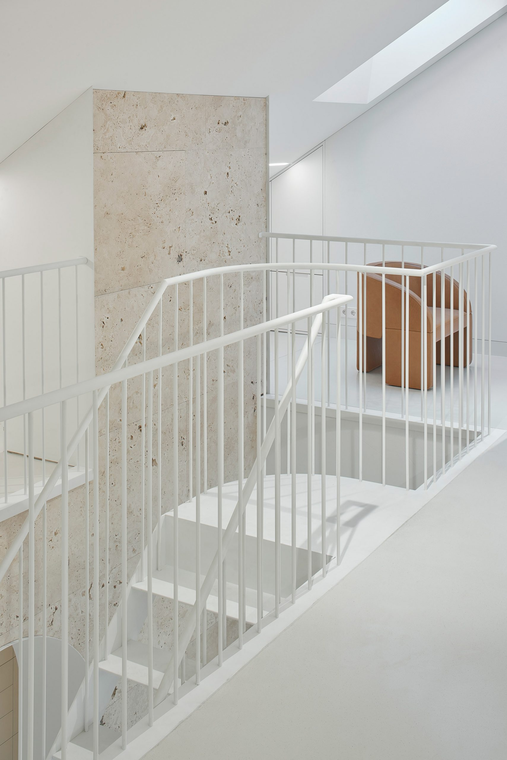 White steel staircase in Vilnius apartment by 2XJ