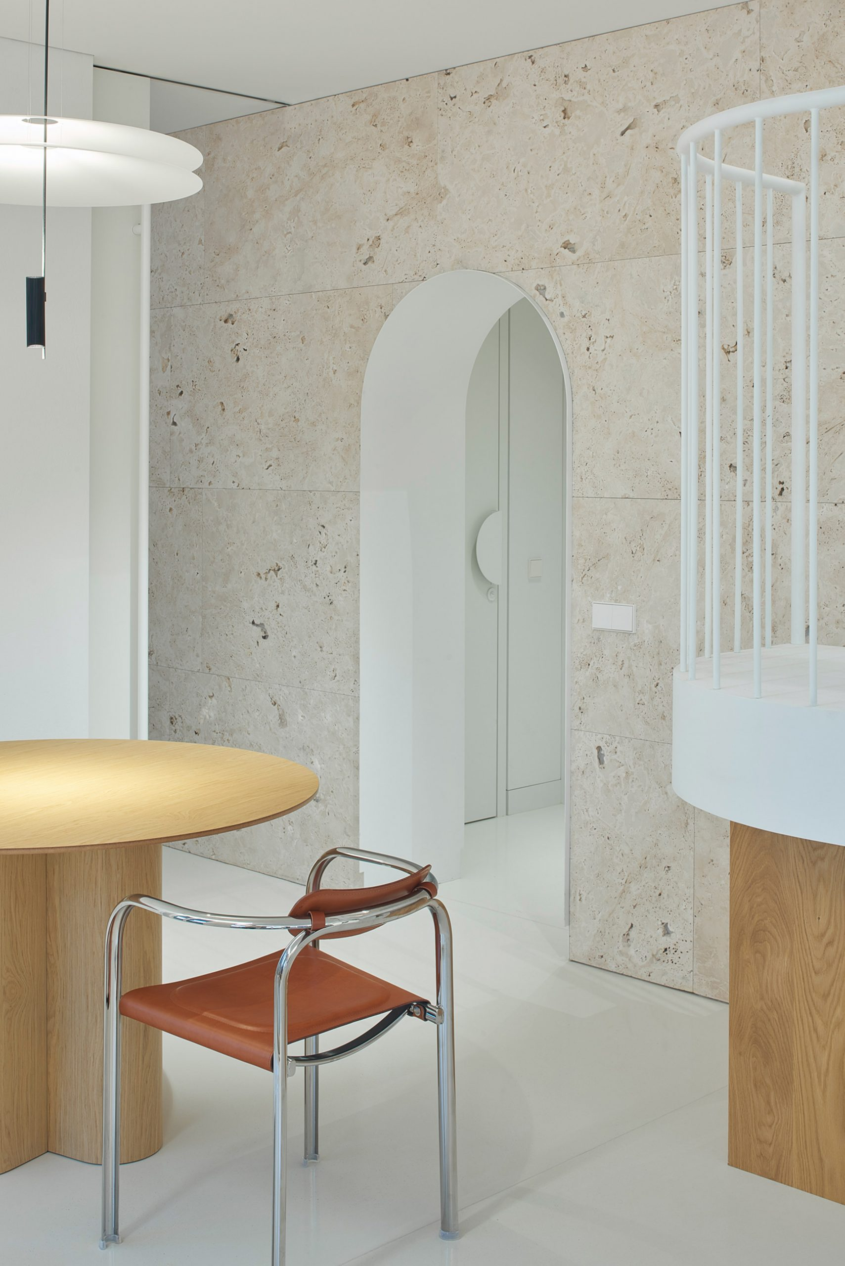 Arched travertine wall in Greetings from Rome apartment