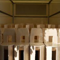 Lamb's chairs stacked up in his rented box van workshop