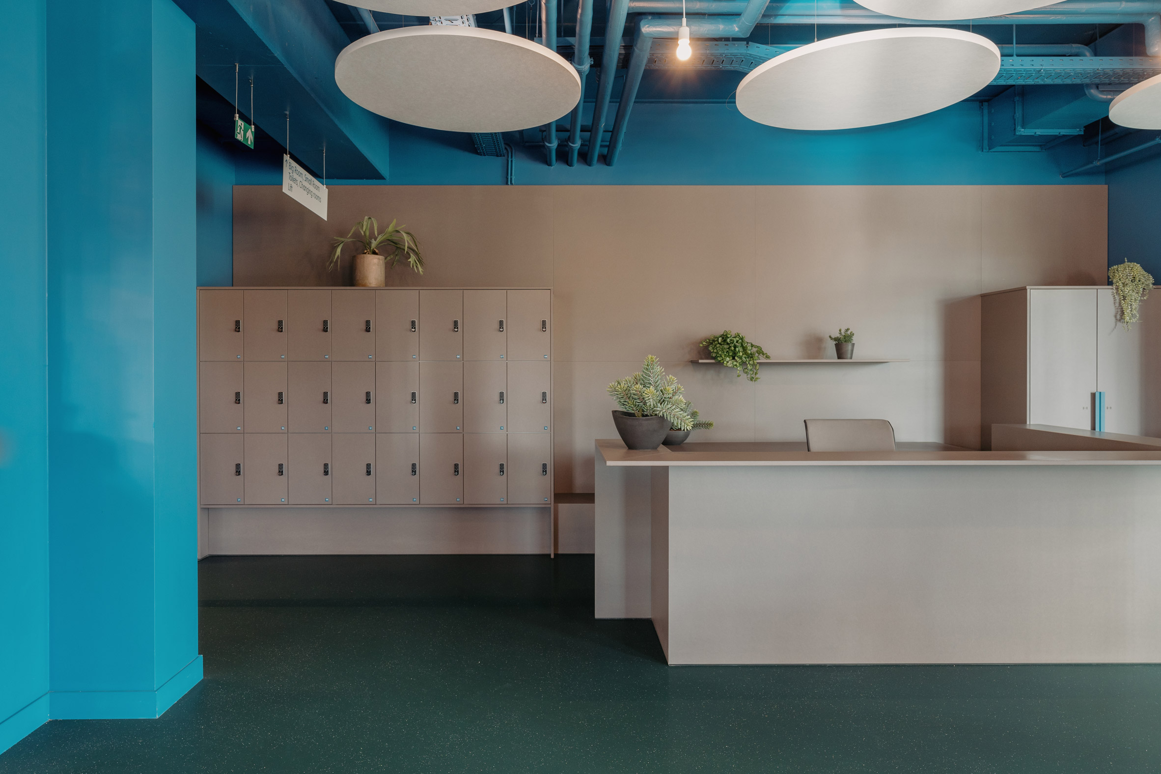 A welcome area is zoned in a muted grey by Studio Anton Hendrik Denys