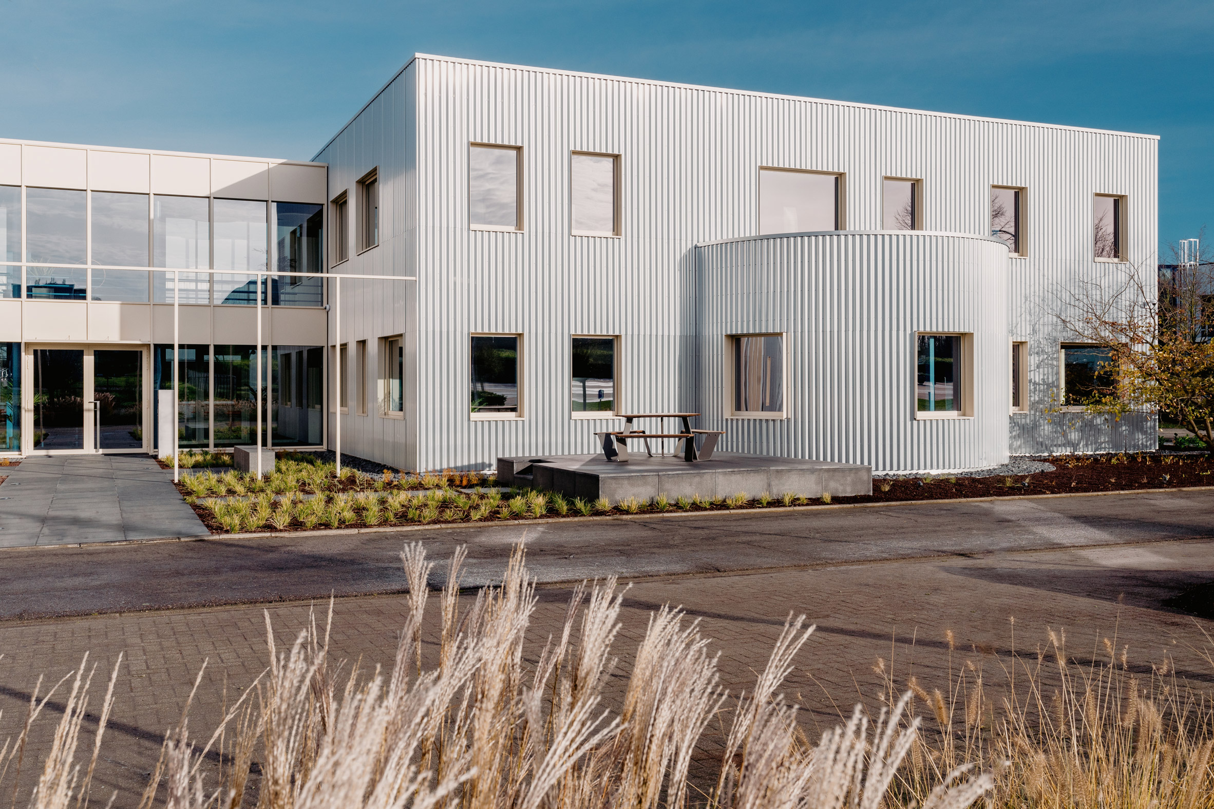 The building has a modular form and is clad in corrugated aluminium