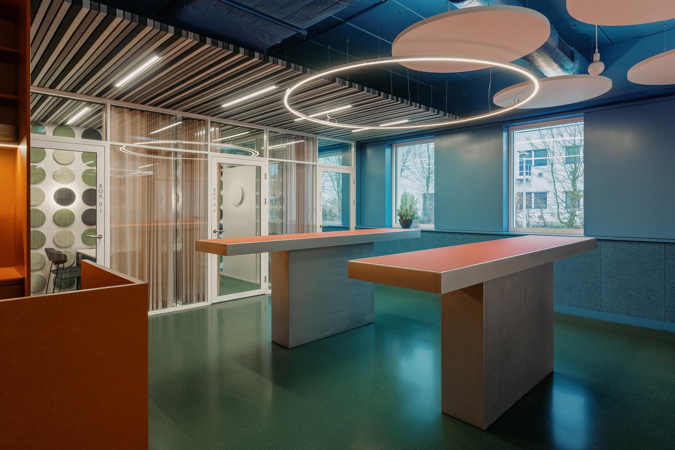 Halo lighting mimics the shape of the acoustic panels