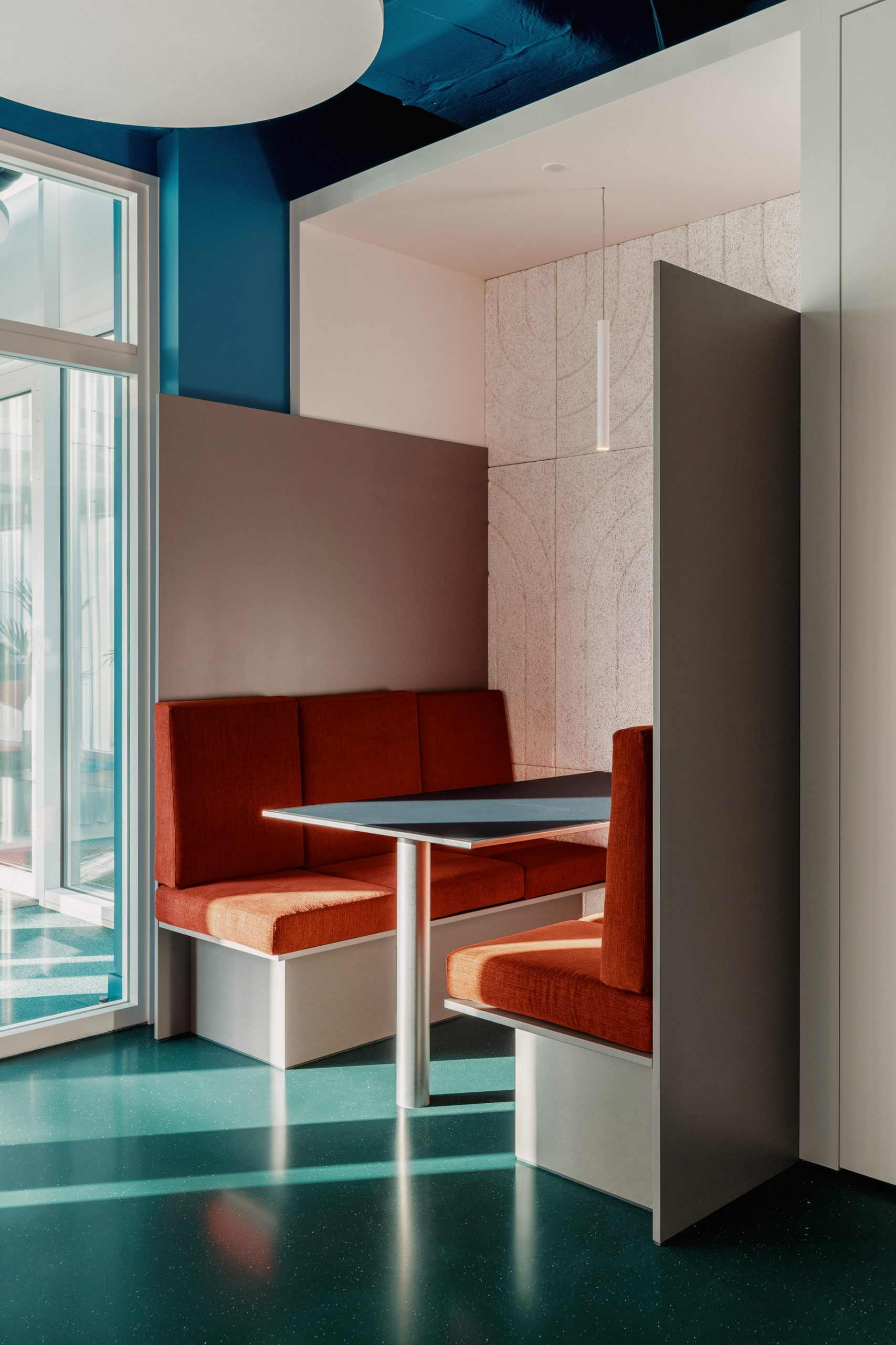 Chairs are upholstered in the company's orange