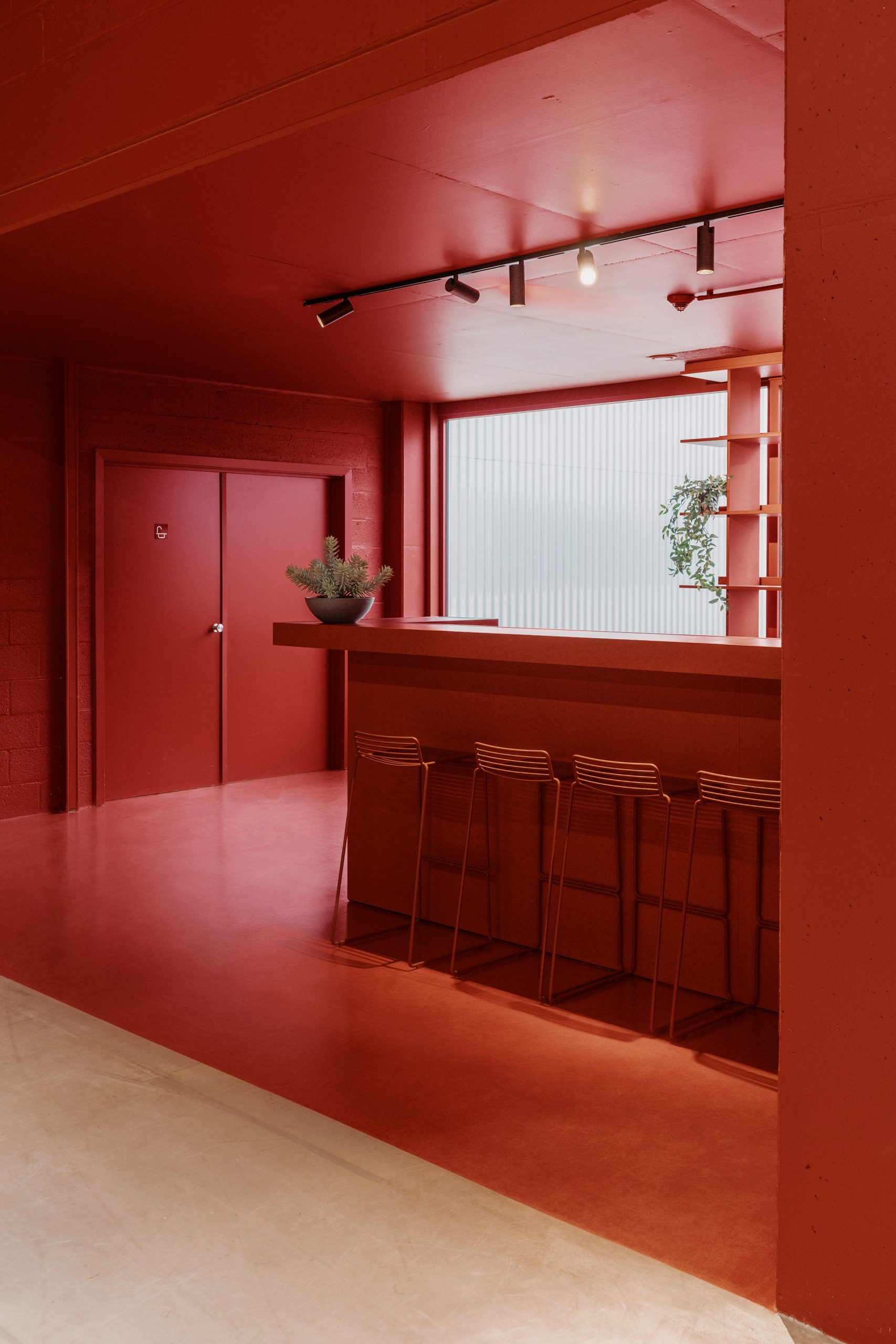 The bar area is painted red by Studio Anton Hendrik Denys