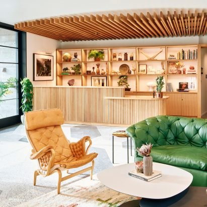 Hotel Magdalena's main lobby with a Moroso green sofa
