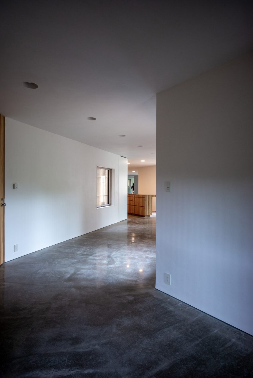 The interior has white walls and a polished concrete floor