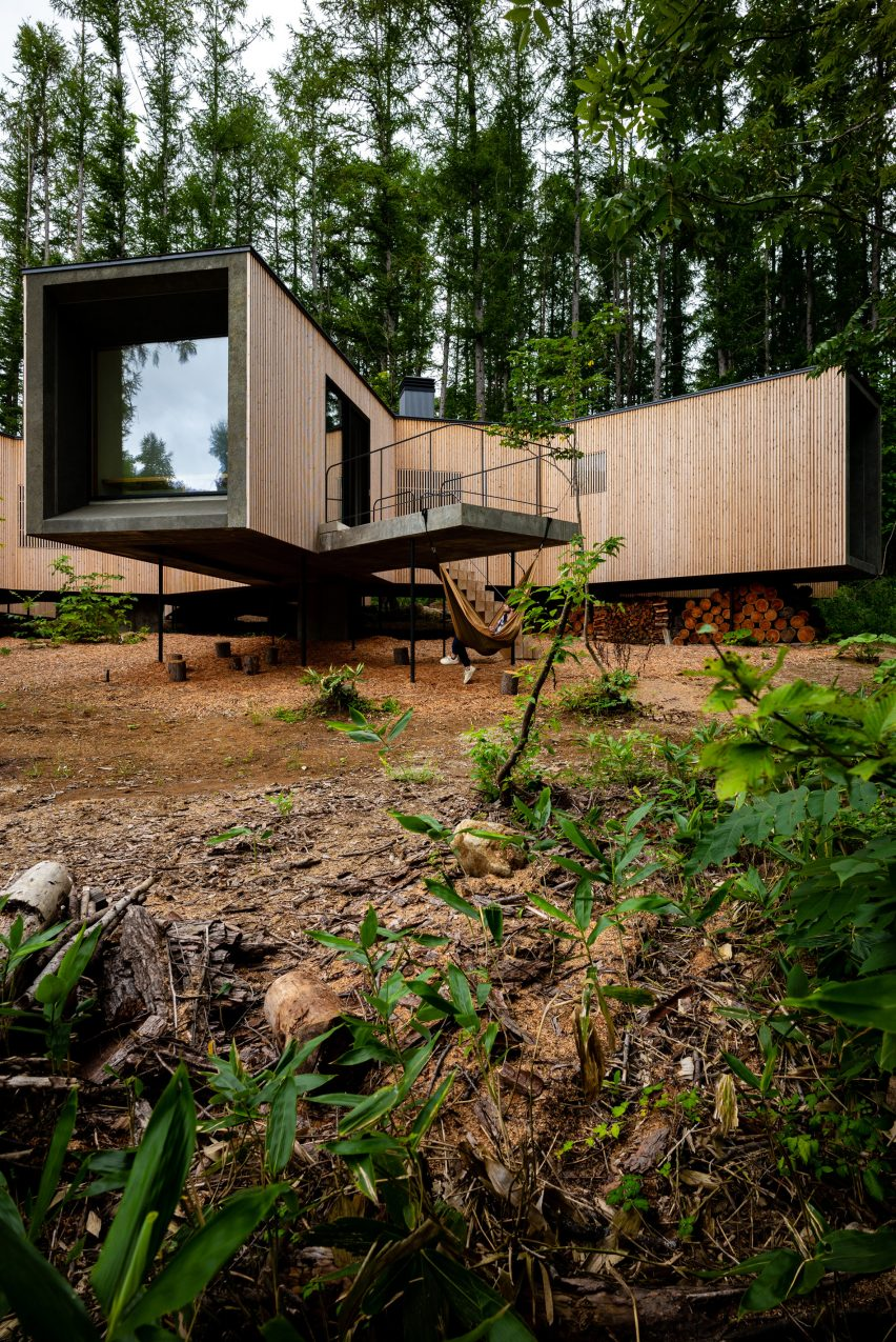 The home sits on steel stilts atop of the sloped terrain