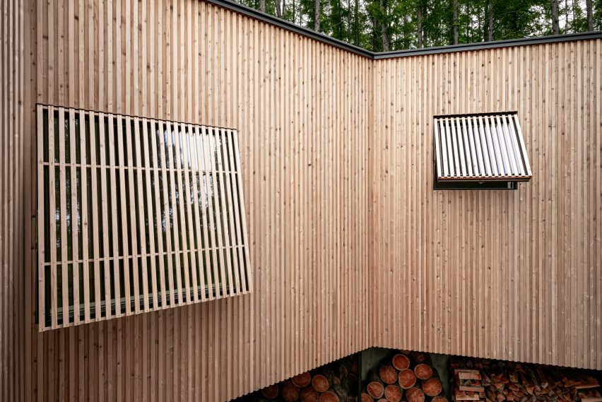 Wooden shade screens cover the windows by Florian Busch