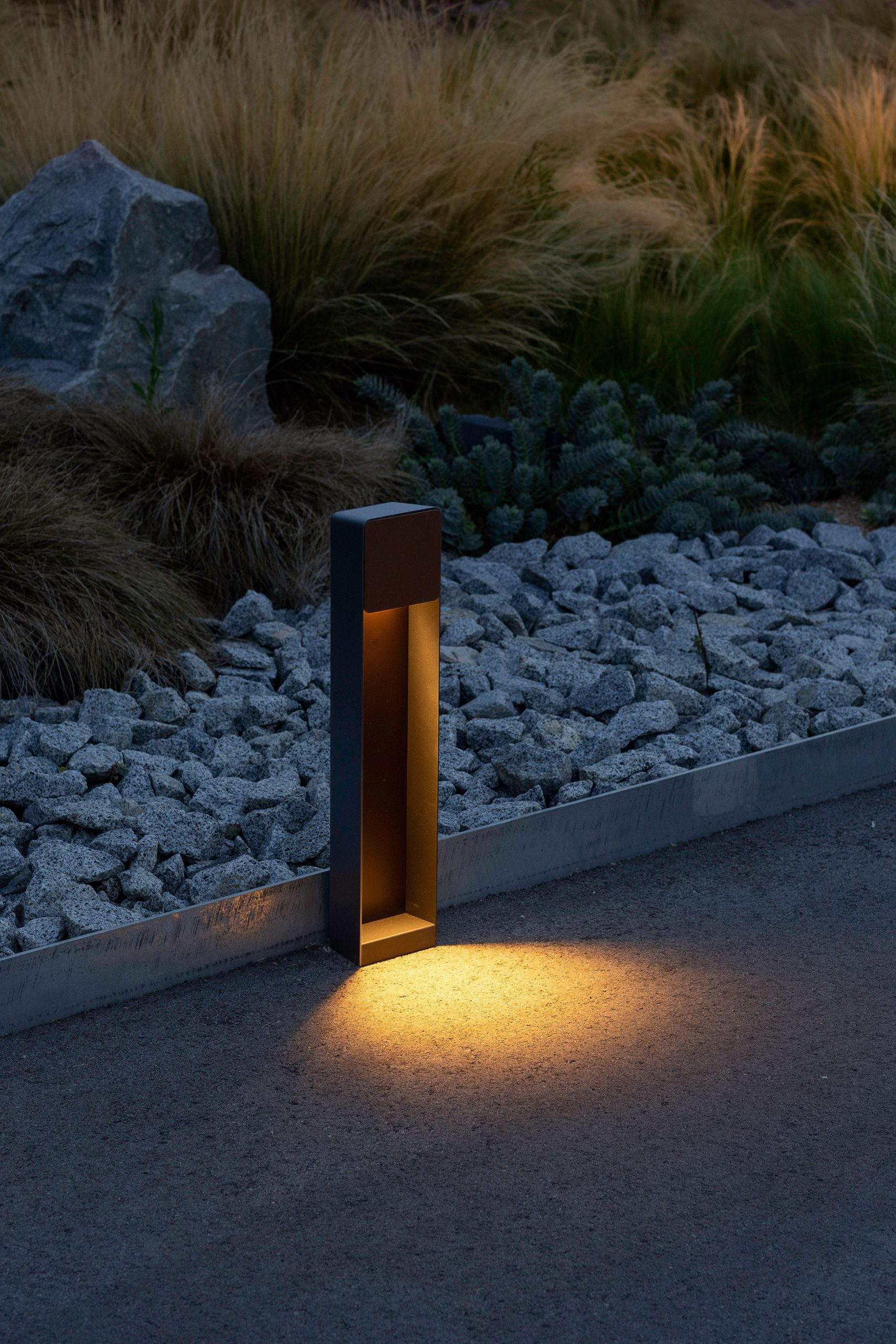 Lab outdoor lamp by Francesc Rife for Marset illuminates a path