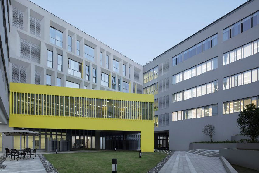 Yellow painted triangular form with slatted windows