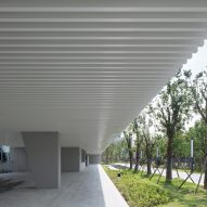 Walkways extend under the structure
