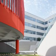 Red library hovers over the courtyard