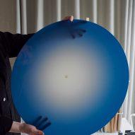 Mette Schelde holds up the Ombre Light