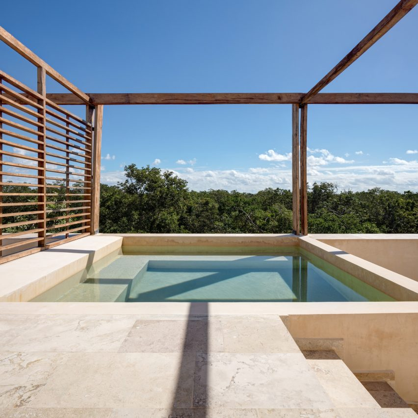 Rooftop pools crown holiday apartments in Tulum jungle by PPAA
