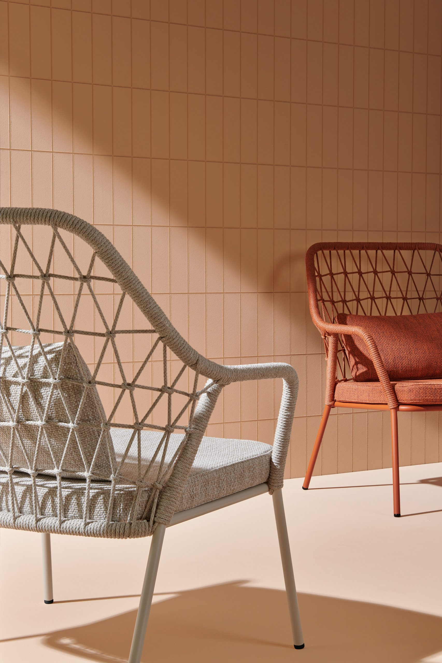 Lounge chairs with wide cushions by CMP Design