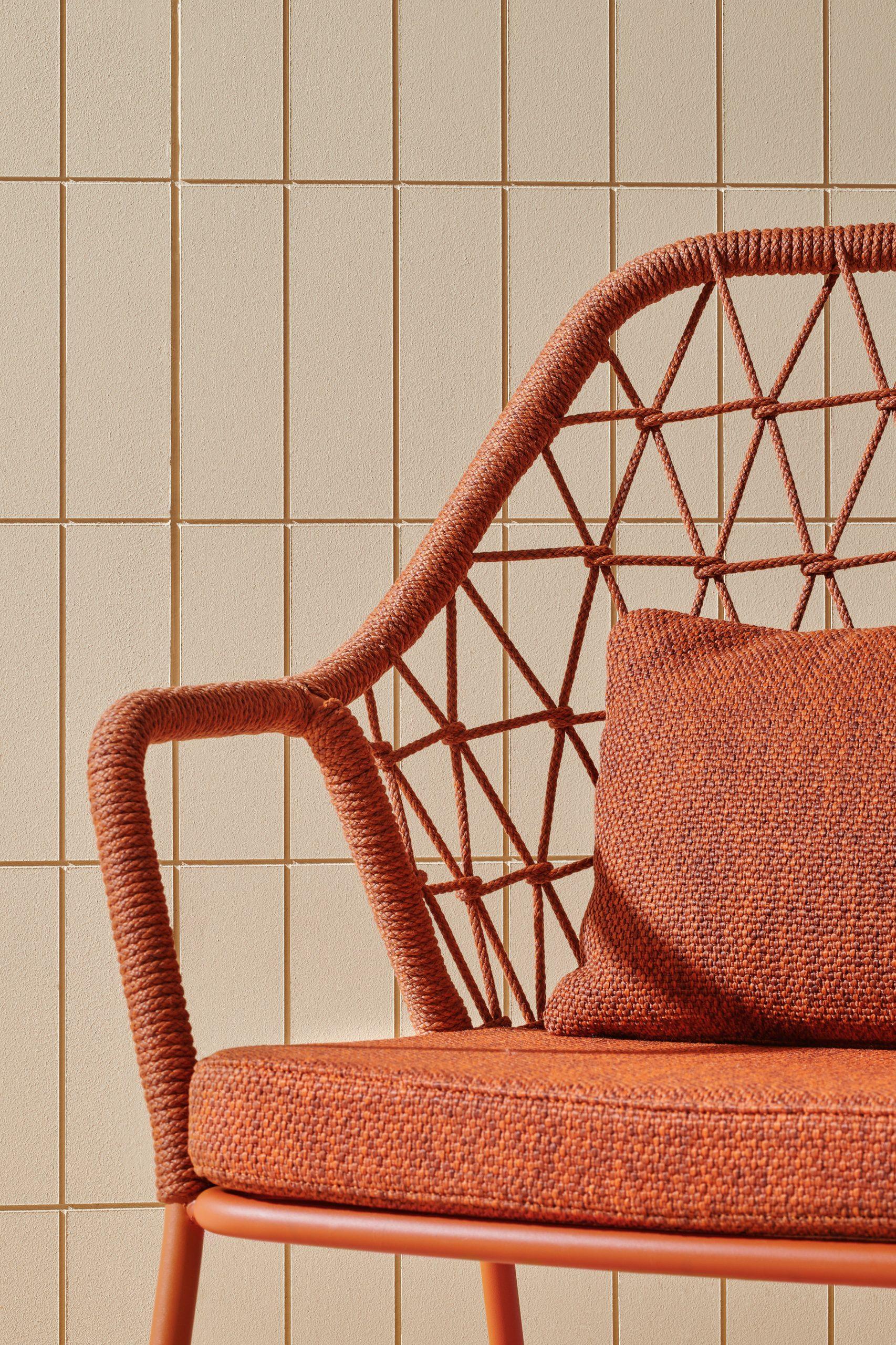 Orange steel frame chair by Pedrali