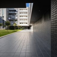 The courtyard has grey tiling