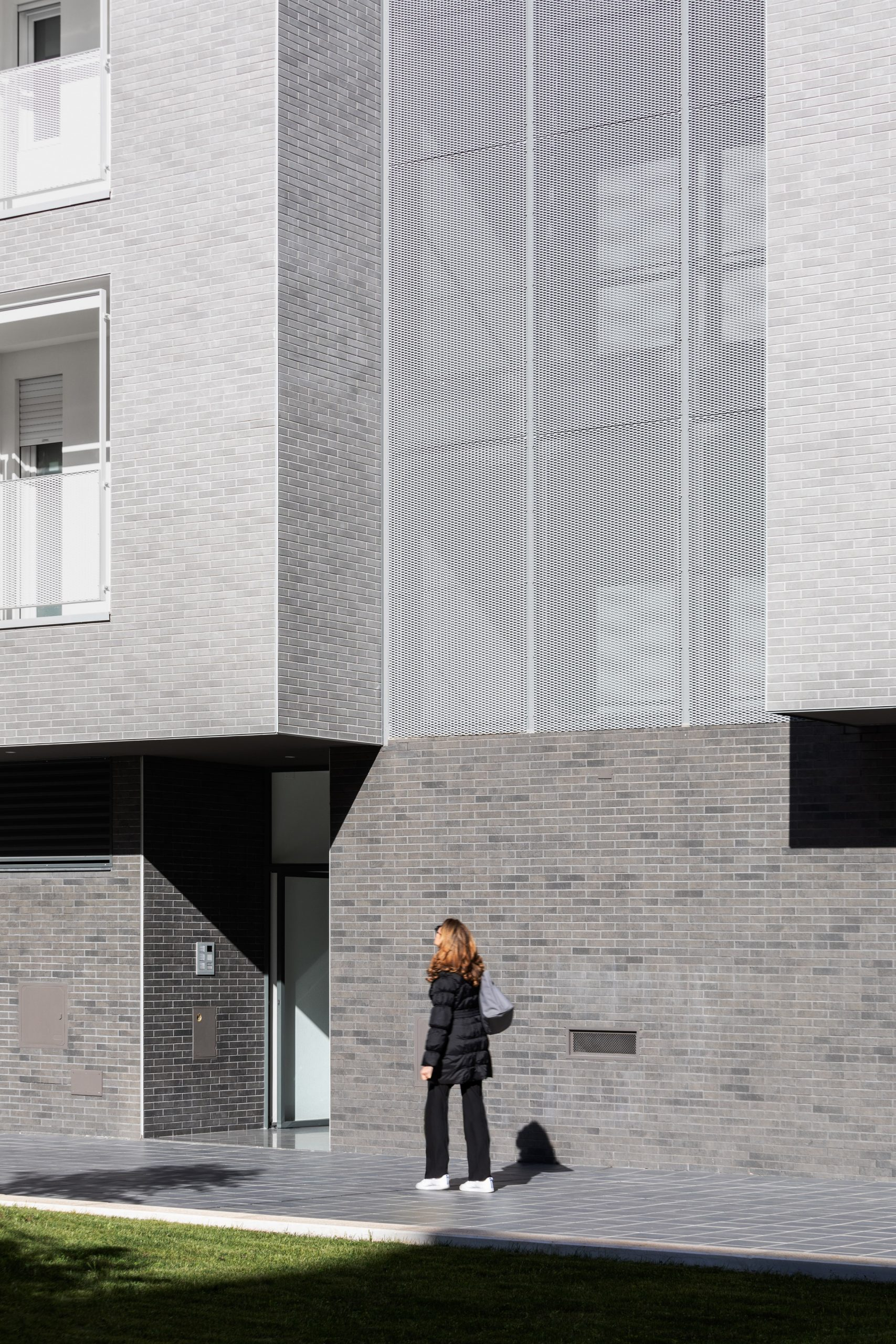 Metal sheets complements the grey brickwork
