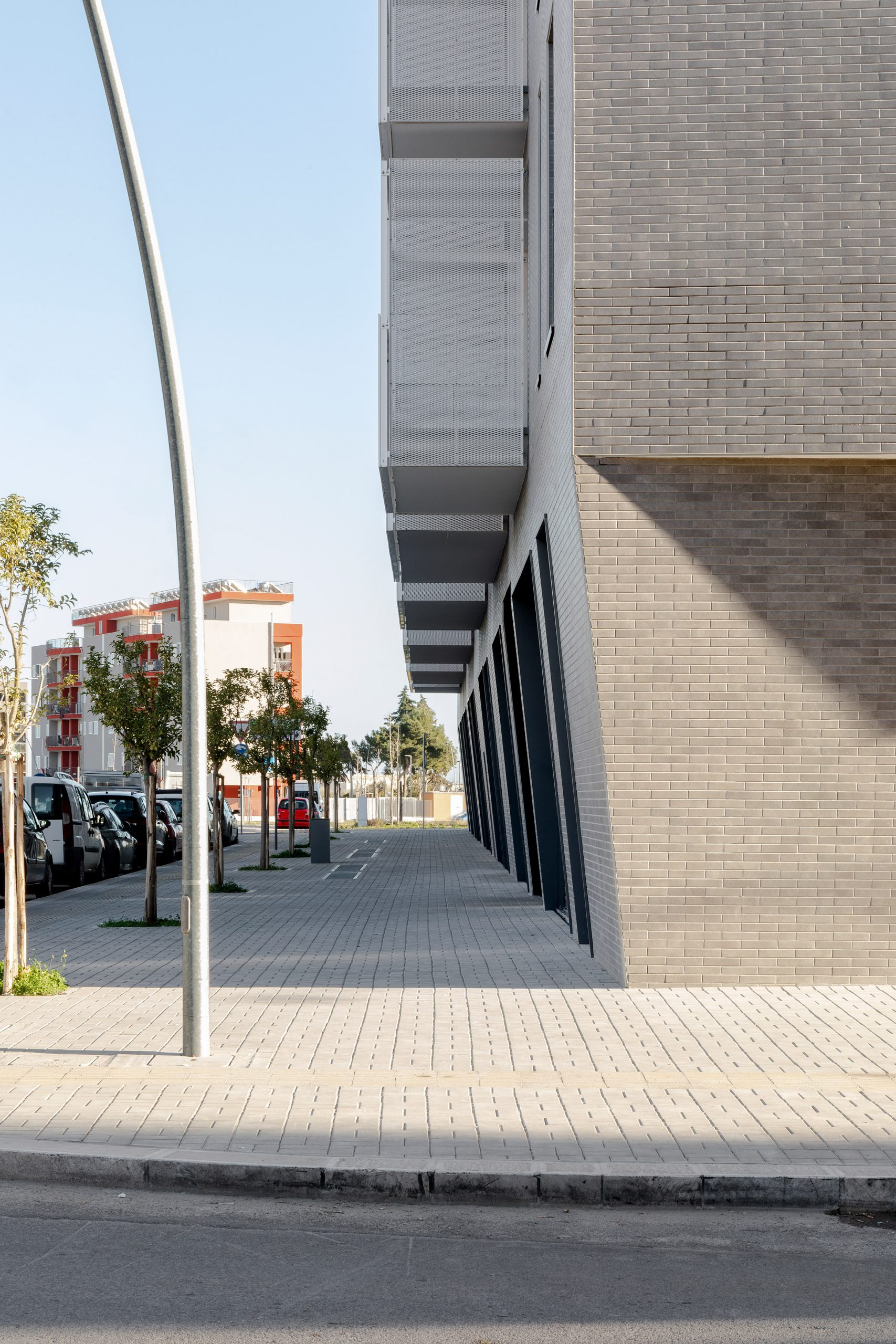 Protruding balconies hang over the street by Alvisi Kirimoto