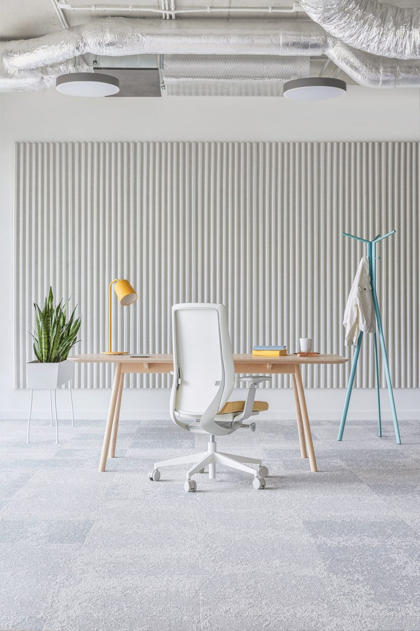 A grey office interior with a white office chair