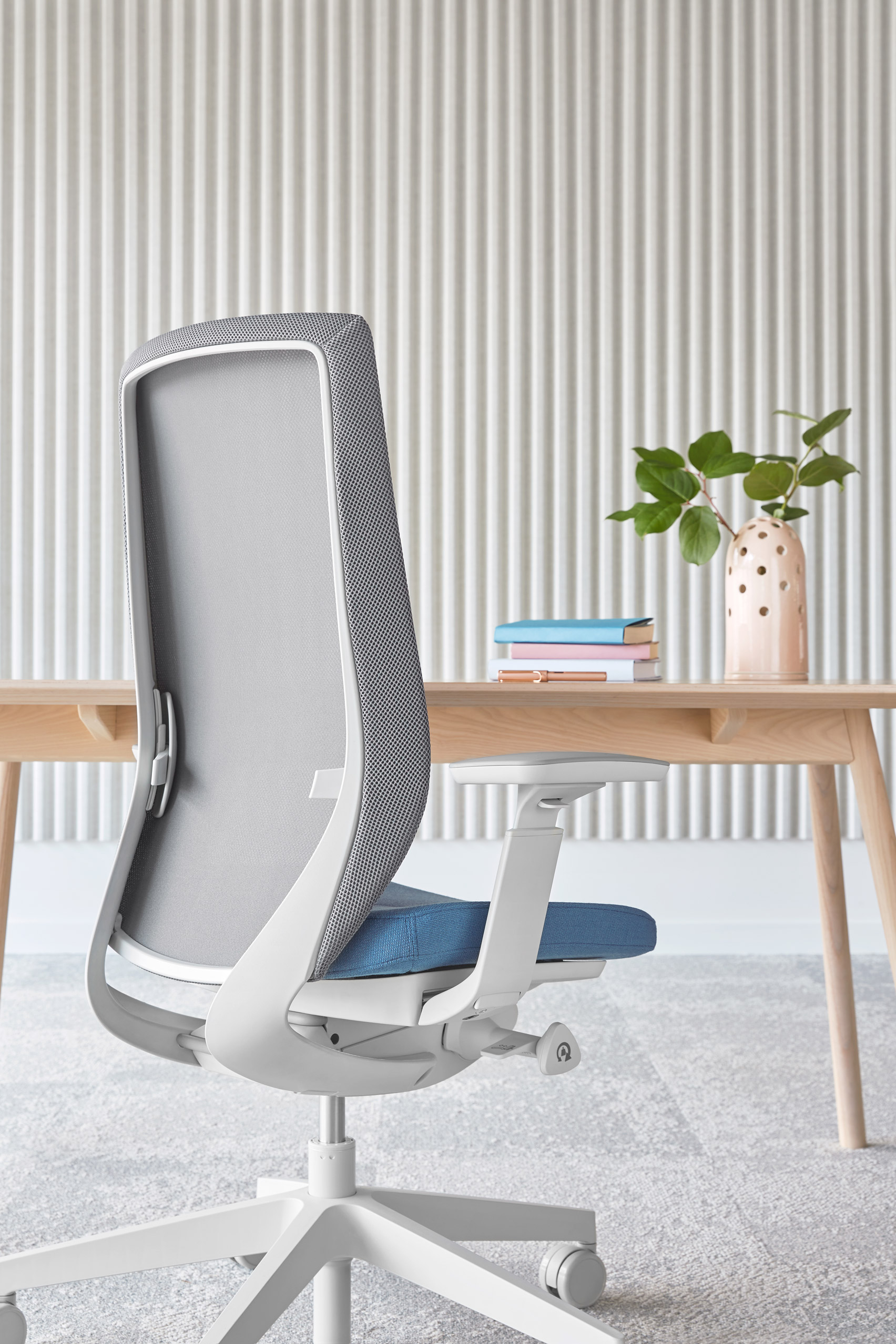 An office chair with a mesh backrest and blue seat