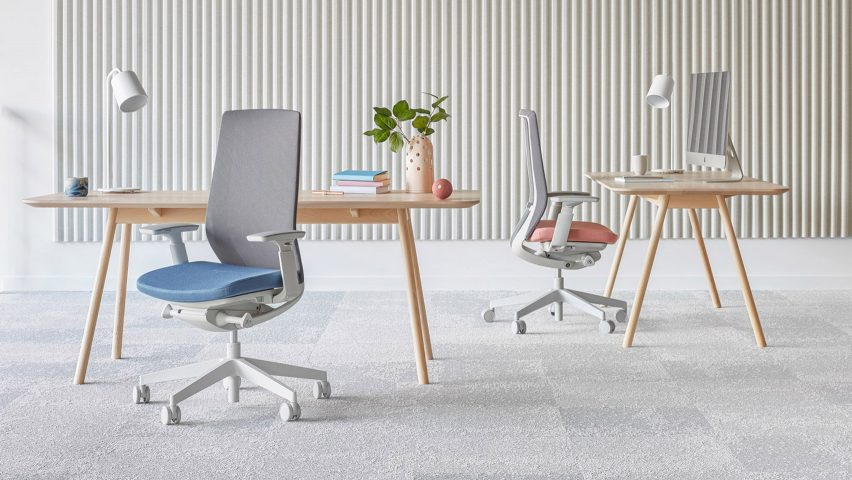 An office featuring two desks and chairs with mesh backrests by Flokk