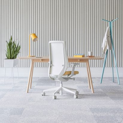 A white office chair with a mesh backrest by ITO Design for Profim
