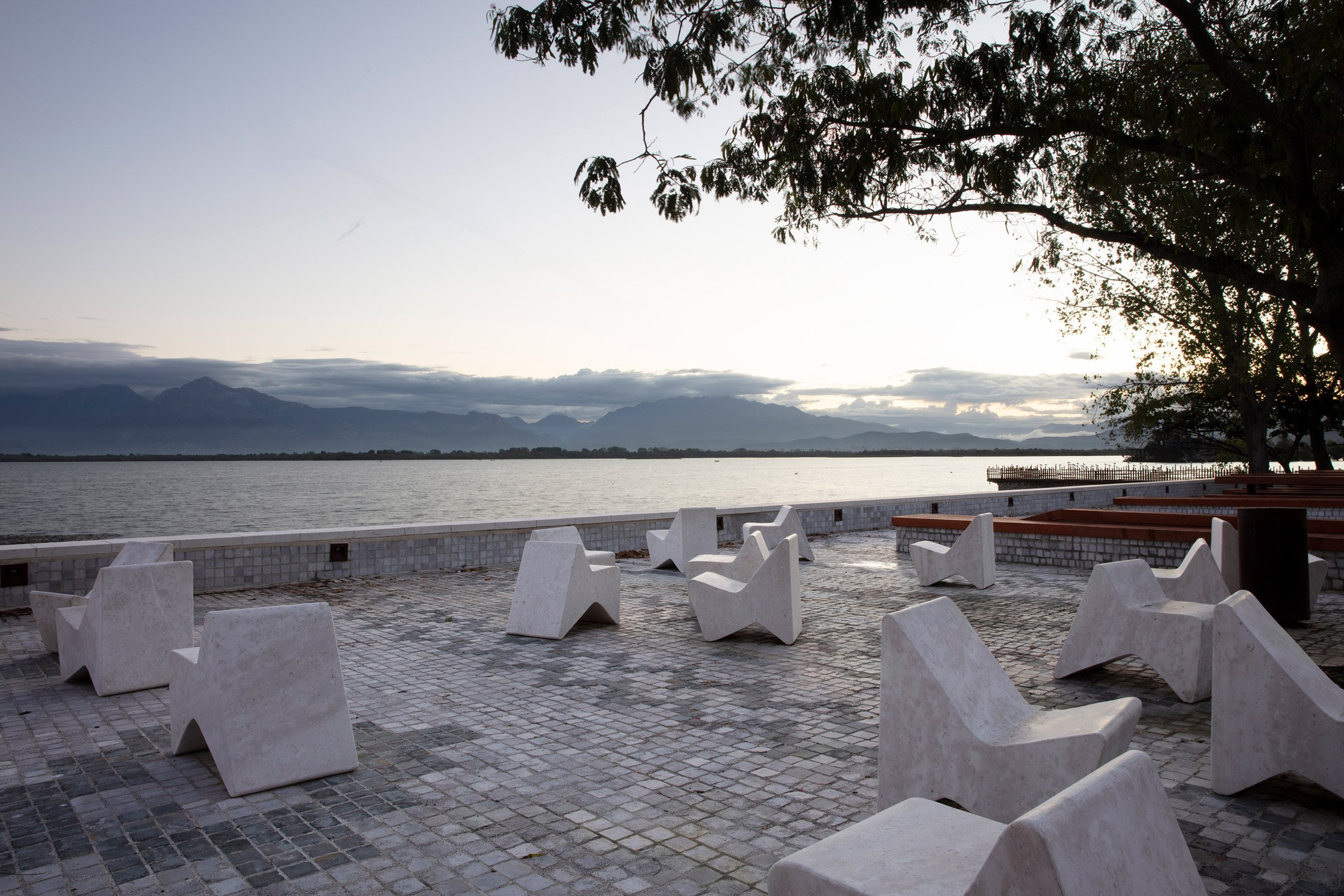 A waterfront with angular street furniture