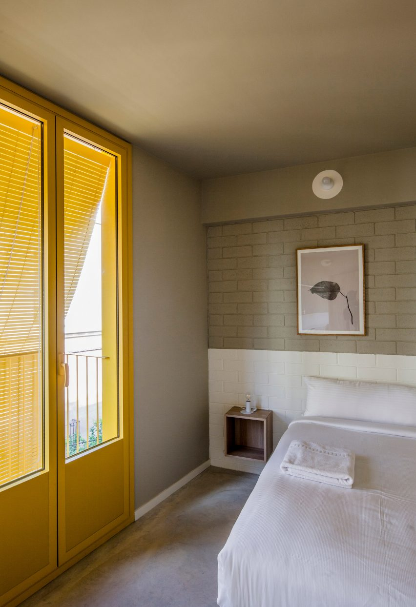 Yellow door frames and blinds provide privacy