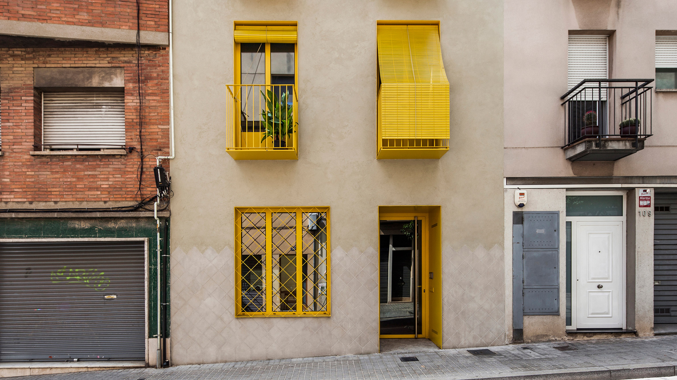 Barcelona apartment building with bright yellow balconies