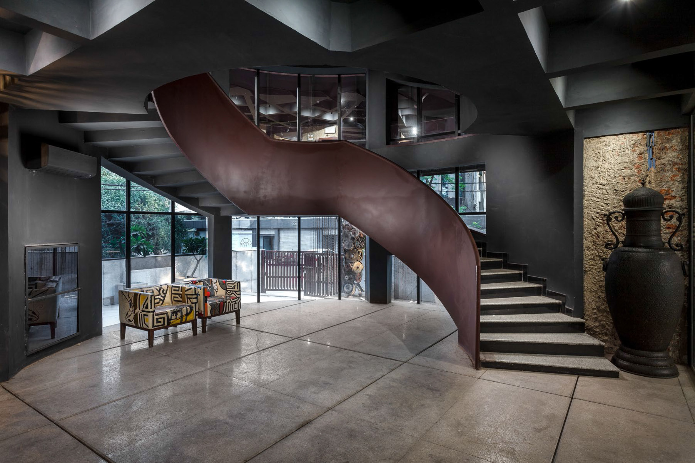 The staircase has a weathered steel finish by Architecture Discipline
