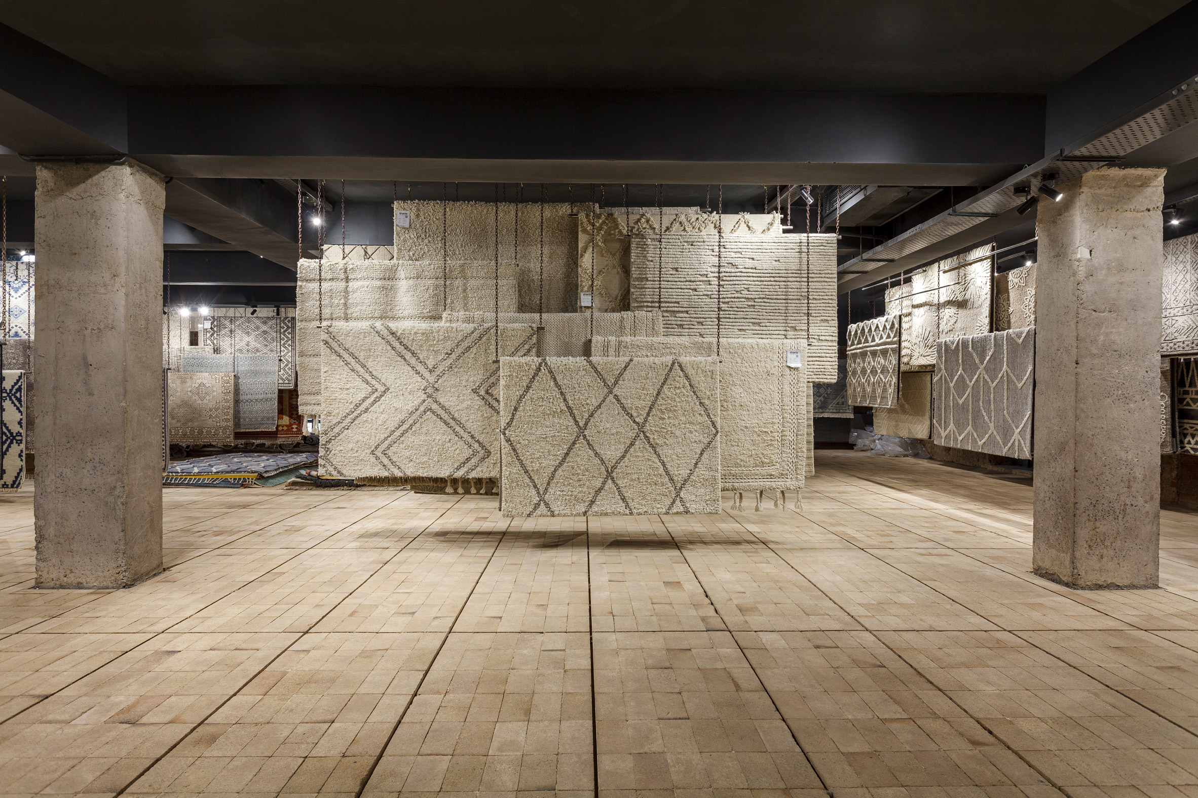 Pale firebrick covers the floors by Architecture Discipline