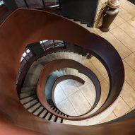 A staircase spirals through the building