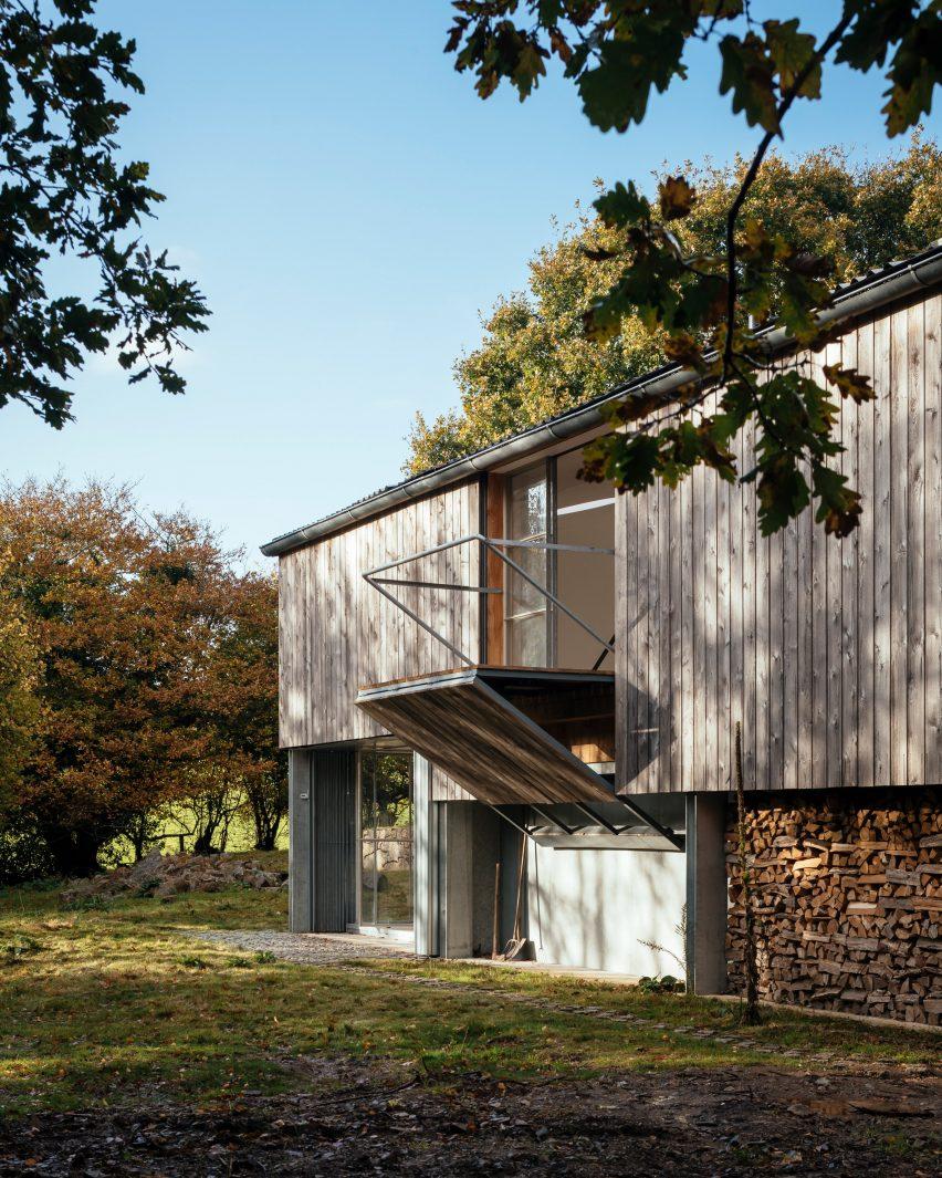 A converted barn with a folding balcony