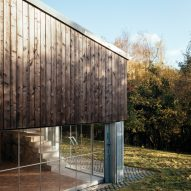 The wood and glass exterior of a converted barn