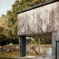 A wood and glass facade of Art Barn