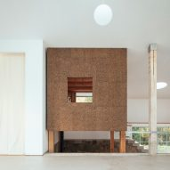 A white-walled studio and cork-clad room