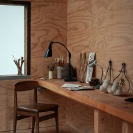 A wood-lined art studio