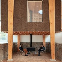 A cork-clad studio and seating area