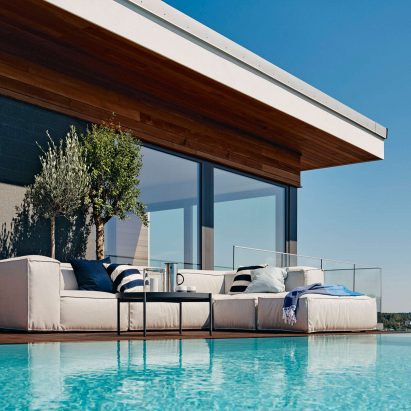 Asker sofa by Martin dos Santos for Skargaarden on a poolside deck