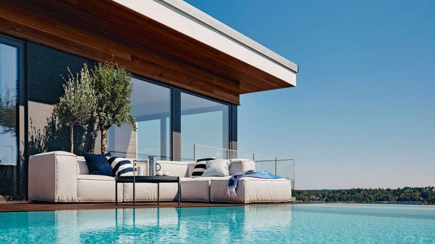 Asker sofa by Martin dos Santos for Skargaarden on a poolside deck