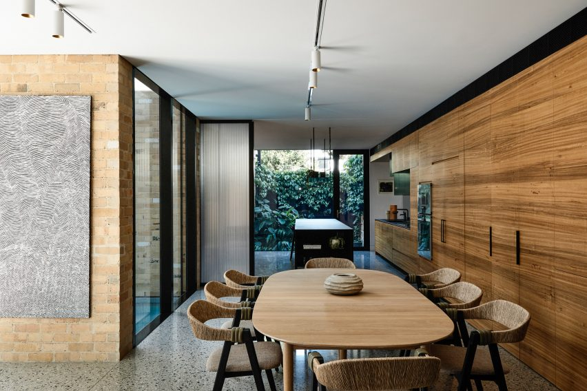 Open plan kitchen diner with wood interiors by Austin Maynard Architects