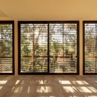 Wooden louvres create shadows