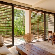 An apartment with wooden louvres