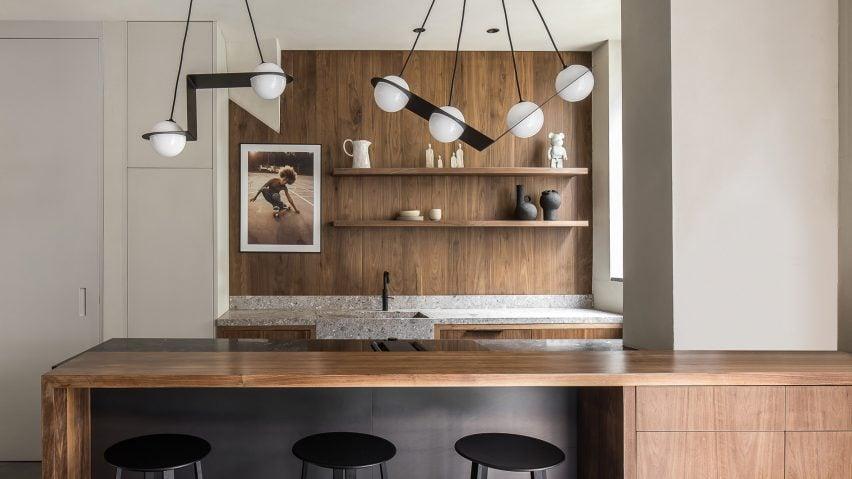 Wood-panelled kitchen of Amsterdam garage tranformation by Barde + vanVoltt