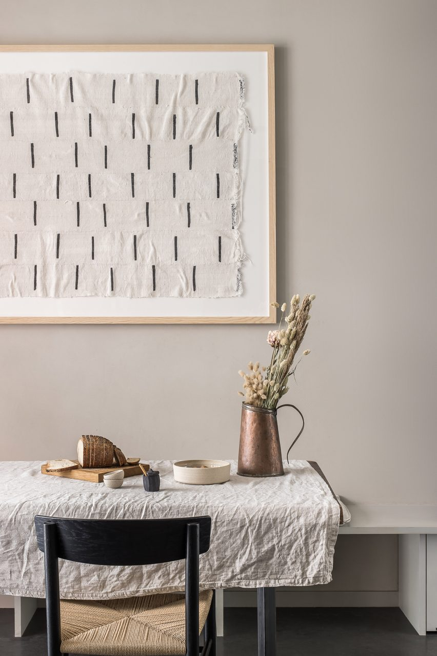 Minimalist dining room with linen tablecloth