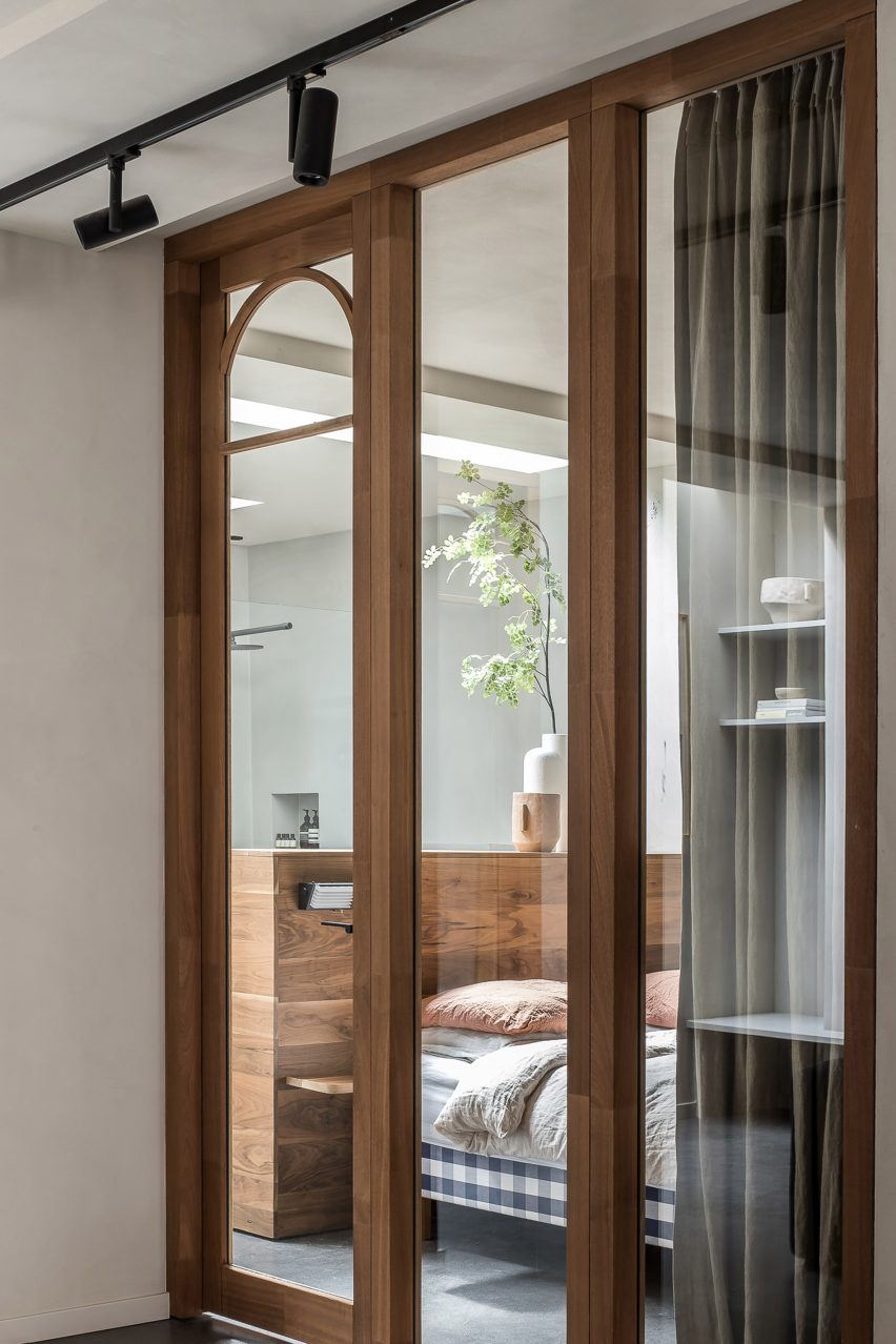 Arched wooden door and window frames inspired by art deco